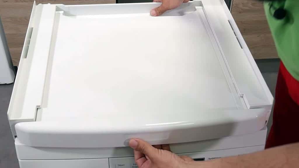 Positionner le plateau sur le lave-linge